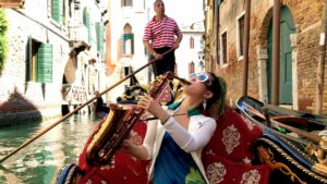 Jazz prodigy Grace Kelly in a gondola in Venice Italy