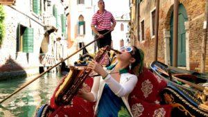 Jazz prodigy Grace Kelly in a gondola in Venice Italy